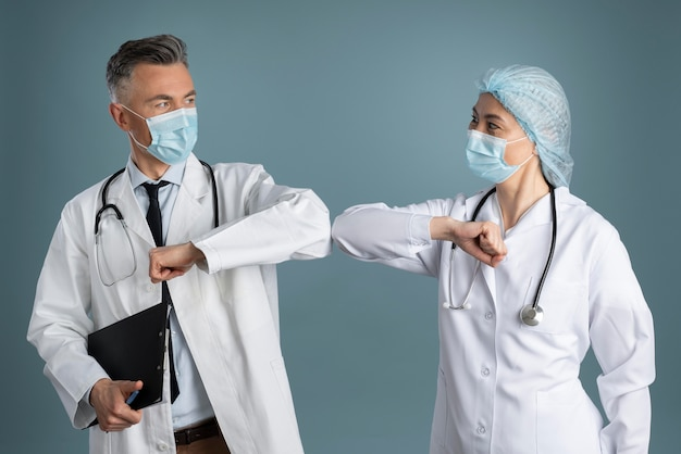 Doctor and nurse in special equipment