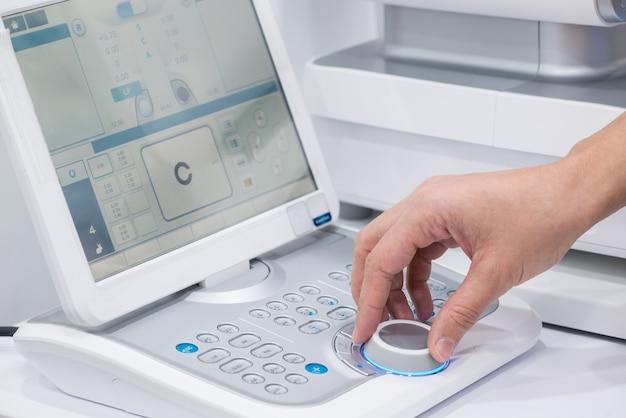 Doctor oculist at work. diagnostic ophthalmologic equipment. medicine concept