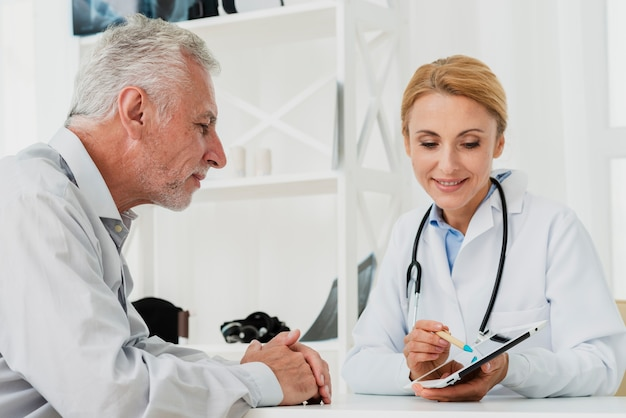 Doctor and patient looking at tablet