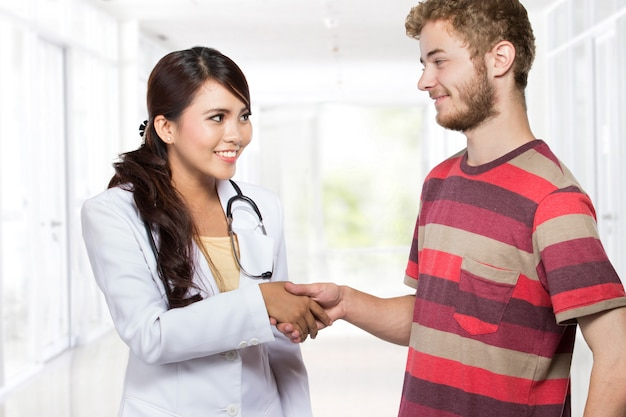 Doctor and patient shake hands