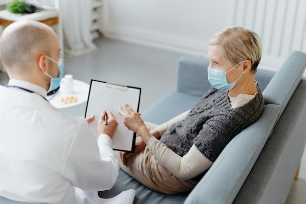 Doctor and patient sitting on the couch in the medical office
