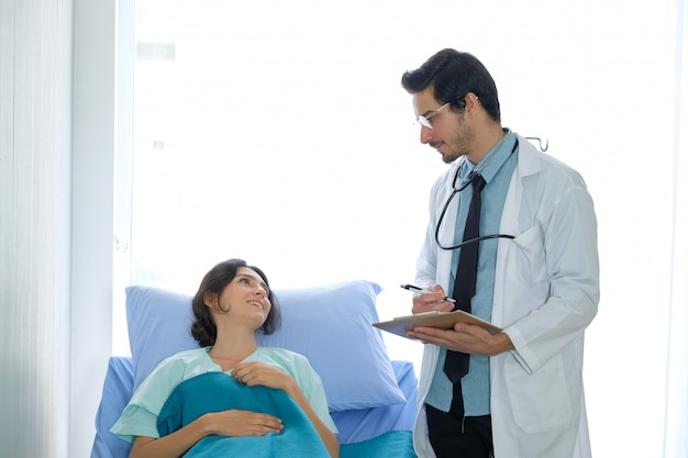 Doctor and patient talking about illness at the hospital