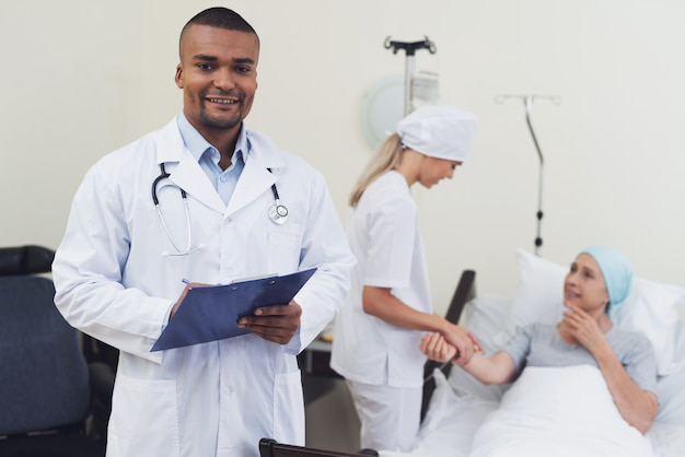 Doctor posing against the background of the patient.