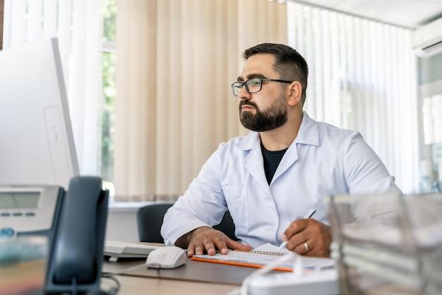 Doctor prescribing medicine. medical worker writing diagnosis. medical office.