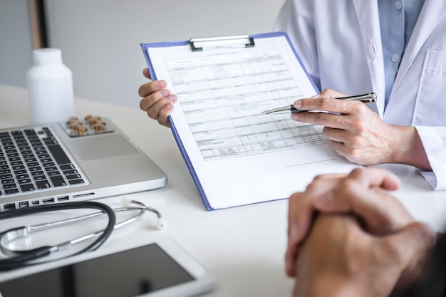 Doctor presenting report of diagnosis symptom of disease and recommend method with patient treatment