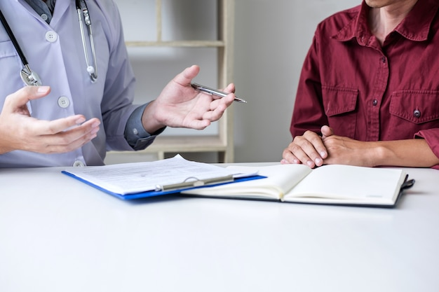 Doctor presenting report and recommend a method with patient treatment