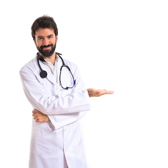 Doctor presenting something over isolated white background