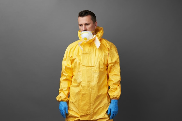 Doctor in a protective suit with medical mask and protective gloves