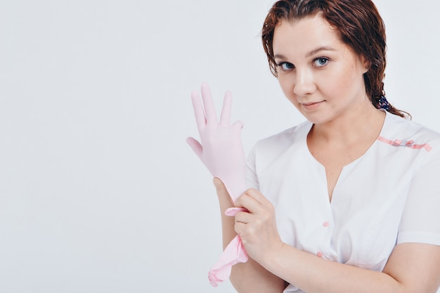 The doctor puts rubber gloves on his hand. the medic is preparing for surgery. concept of medicine, medical instruments, healthcare. isolated, copy space