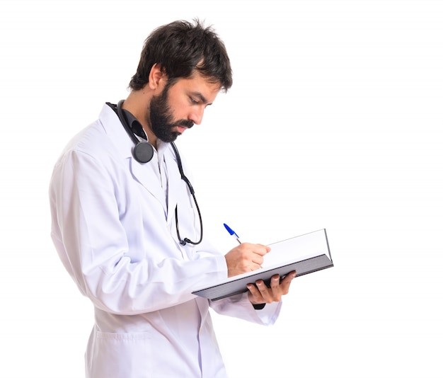 Doctor reading a book over white background