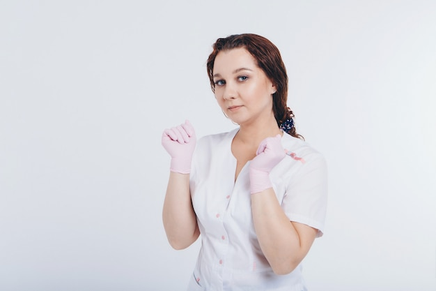 The doctor in rubber gloves. a girl wears a protective gear during an epidemic. ads for antiseptics and medical equipment
