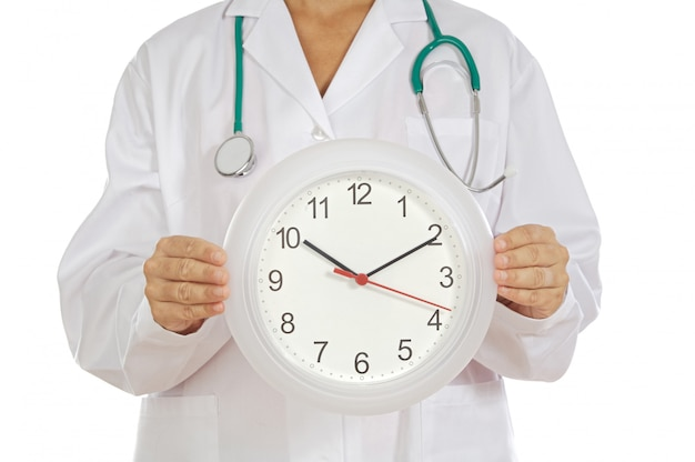 Doctor´s hands showing clock over white background