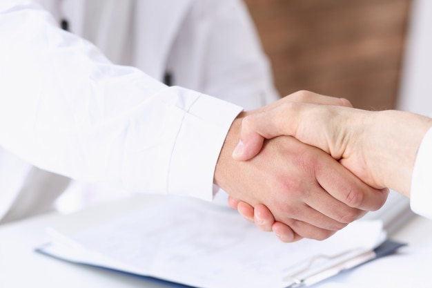 Doctor shake hand as hello with patient