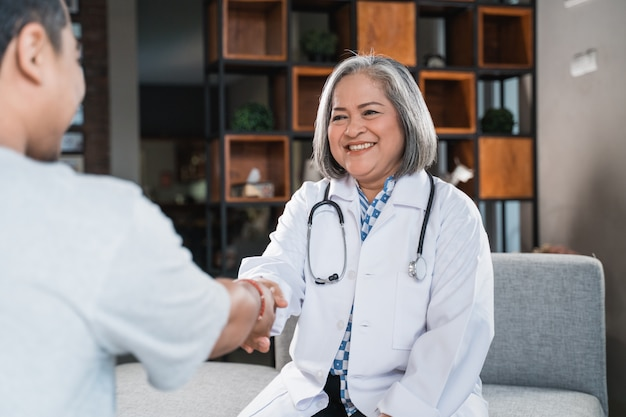 Doctor shakes hands with the patient