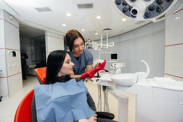 The doctor shows a cast of the patient's jaw. dentistry