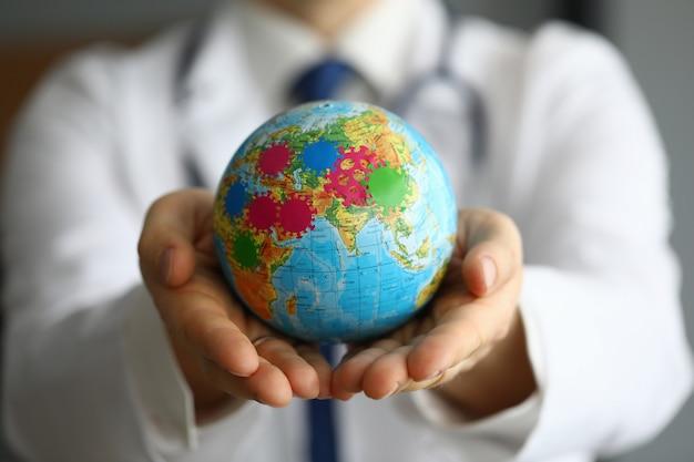 Doctor shows globe with coronavirus, world pandemic