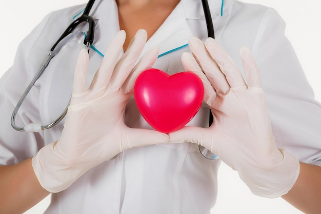 The doctor shows heart isolated on a white background