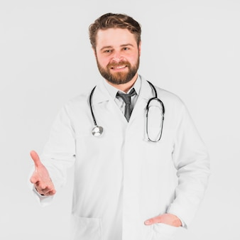 Doctor smiling and offering hand