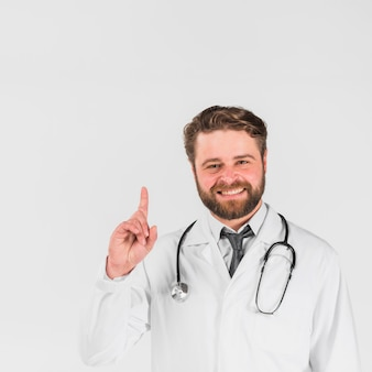 Doctor smiling and pointing finger up