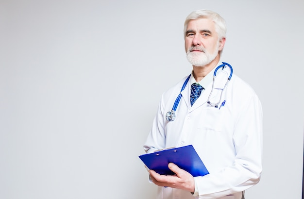 Doctor standing with a folder and a stethoscope