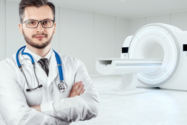 The doctor stands in front of the mri machine
