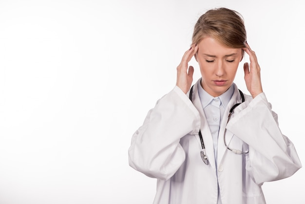 Doctor stressed - migraine and headache people. health care prof