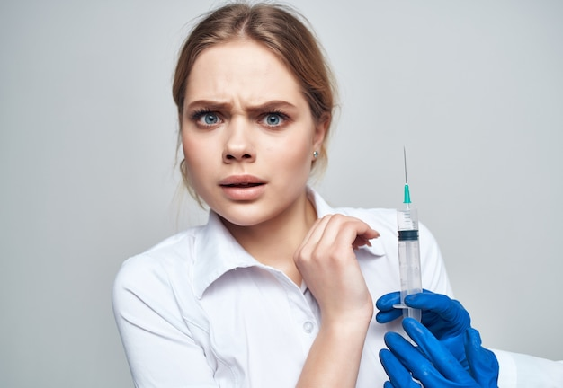 Doctor syringe in hand treatment isolated background