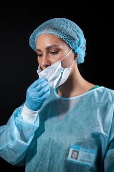 Doctor taking off face mask medium shot