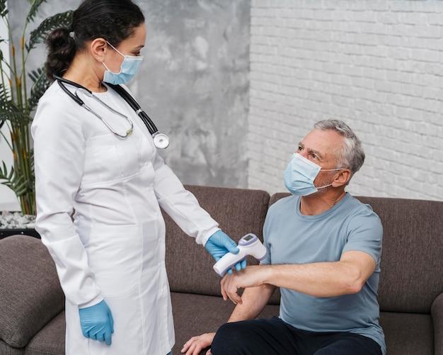 Doctor taking patients temperature
