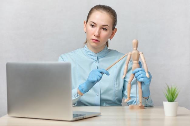 Doctor teacher tells online lessons.