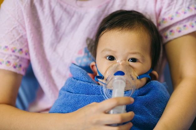 Doctor treatment a child who sick by chest infection of asthma or pneumonia cause by virus