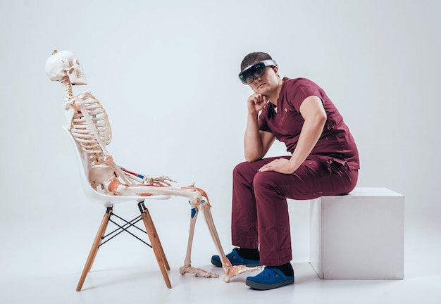 Doctor uses augmented reality goggles to exam human skeleton