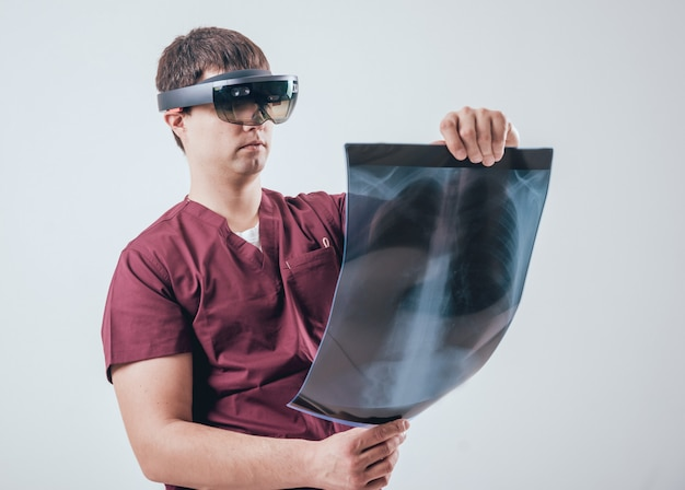 Doctor uses augmented reality goggles to exam x-rays film with human skeleton