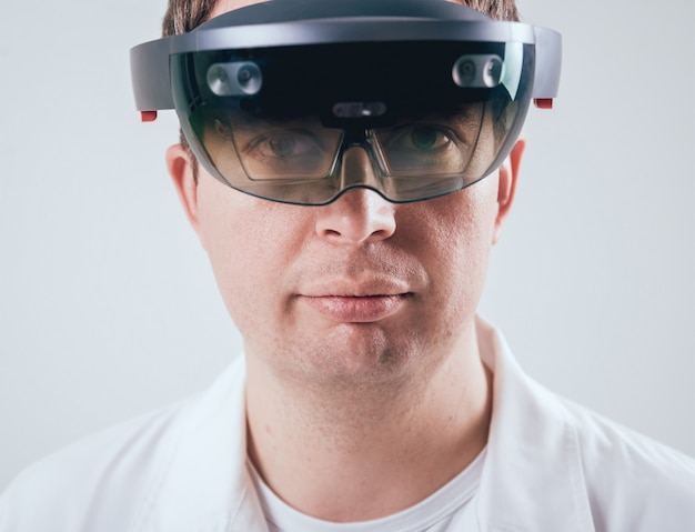 Doctor uses augmented reality goggles.