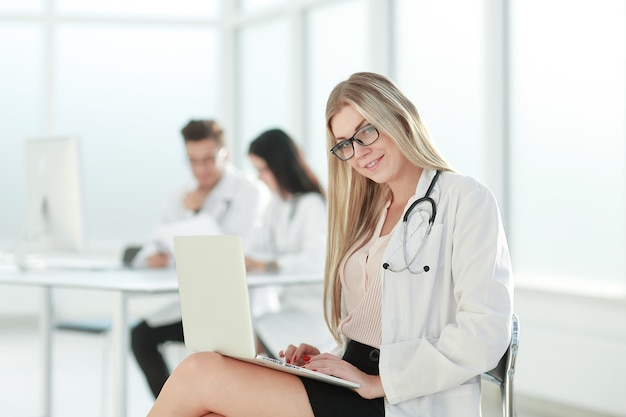 Doctor uses a laptop to work with documents .photo with copy space