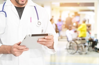 Doctor using digital tablet find information patient medical history at the hospital.