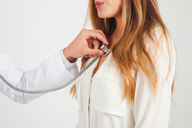 Doctor using stethoscope