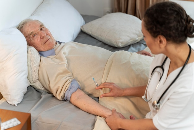 Doctor vaccinating a senior patient
