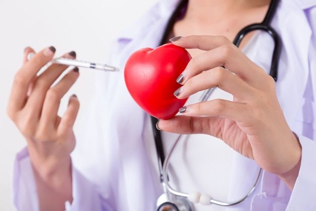 Doctor vaccination to the red heart.