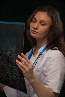 Doctor viewing mri brain