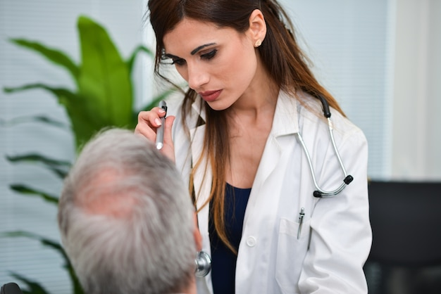 Doctor visiting the eyes of a patient