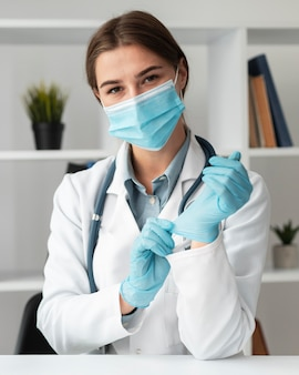 Doctor wearing face mask at the clinic