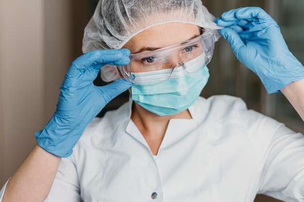 Doctor wearing a face mask and protective goggles