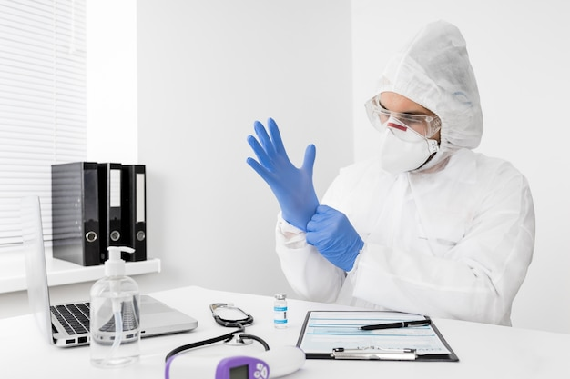 Doctor wearing a face mask and surgical gloves