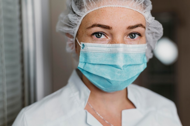 Doctor wearing a face mask at work