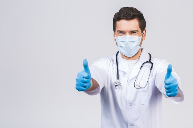 Doctor wearing gloves and medical mask. medical concept corona virus. thumbs up.