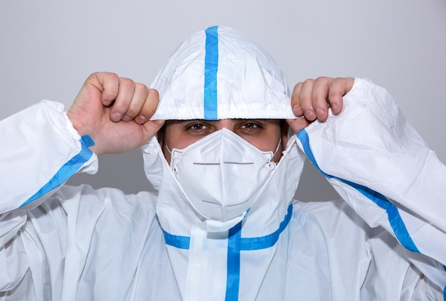 Doctor wearing medical protective suit and  mask. protection mers by virus epidemic. coronavirus (covid-19). healthcare concept.