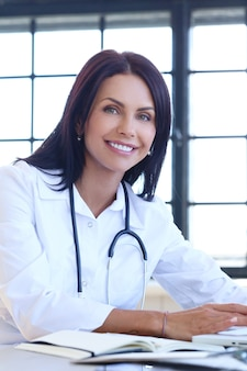 Doctor wearing white robe and stethoscope
