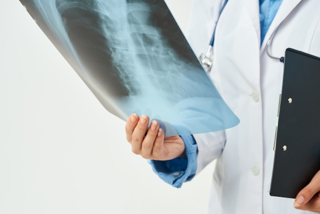 Doctor in white coat diagnostics patient scan hospital work