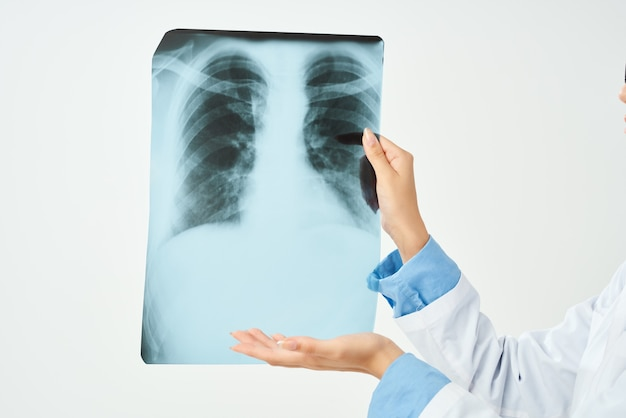 Doctor in white coat with x-ray health care isolated background. high quality photo